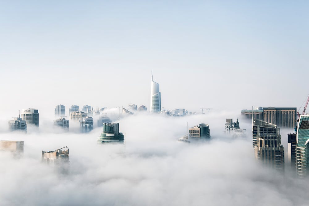 cloudy-city-clouds-fog-white-volume-faded-see-buildings-business